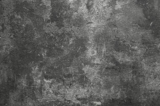 Texture de béton foncé se bouchent