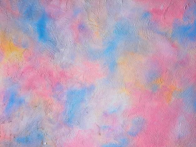 Texture de béton multicolore se bouchent