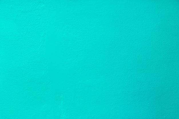 Texture de béton de mur de vieux grunge de couleur bleu de mer comme toile de fond.