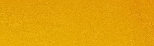 Texture de béton de mur vieux grunge de couleur jaune comme toile de fond.