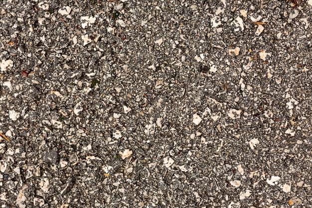Texture béton avec roches et galets