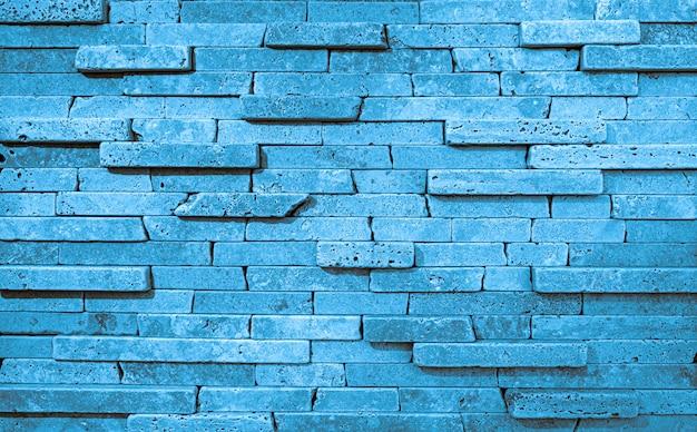 Texture bleue du mur de pierre. fond de blocs de travertin de haute qualité