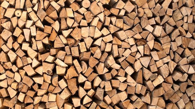 Texture, bois de chauffage haché de différentes espèces d'arbres d'arrière-plan