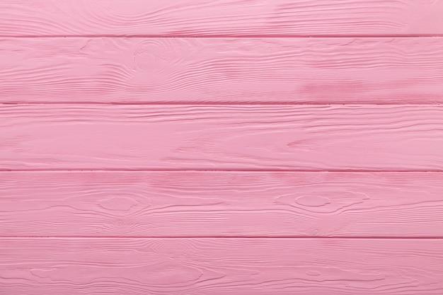 Texture en bois ou fond de table rose pastel