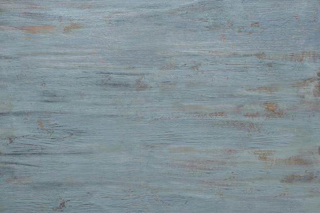 Texture bois gris-bleuâtre clair avec peinture craquelée.
