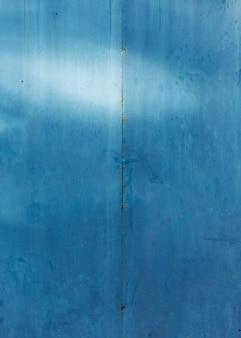Texture en bois peint en bleu monochrome