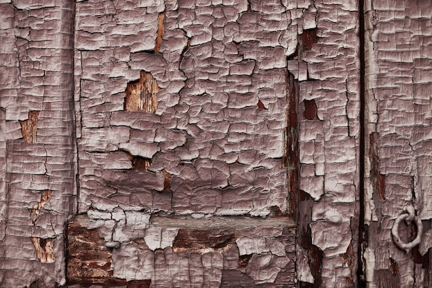Texture bois avec peinture écaillée fond marron
