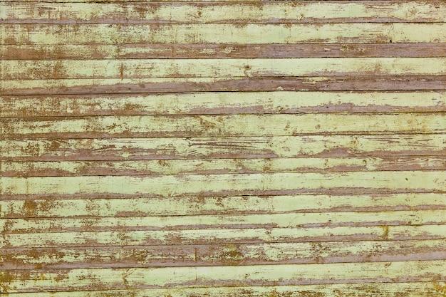 Texture en bois des planches dans la vieille peinture, fond de texture de planches de bois pastel.