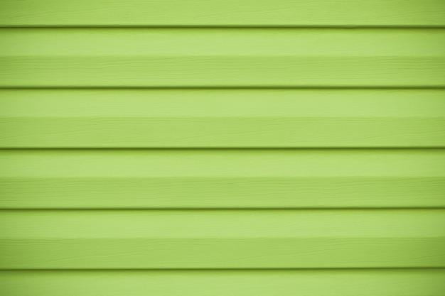 Texture en bois vert à rayures horizontales. planche de couleur citron vert, mur jaune en lignes.