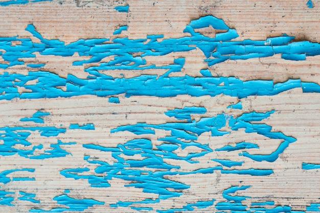 Texture en bois avec de la vieille peinture bleue fissurée