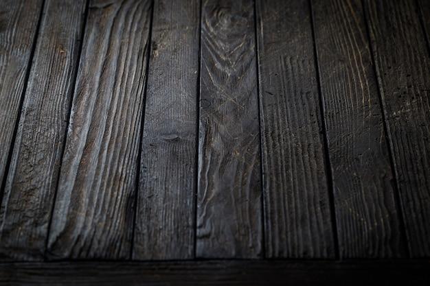 Texture bois vintage noir, table sombre