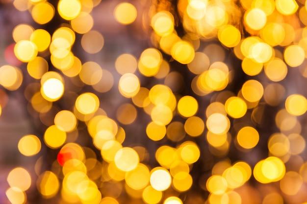 Texture de bokeh de lumières jaunes. lumières de noël estompées
