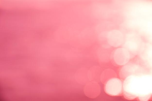 Texture de bokeh rose. fond de paillettes festive avec des lumières défocalisés