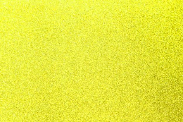Texture brillante de paillettes jaunes pour noël, concept de célébration.