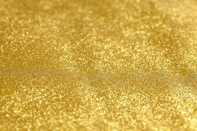 Texture brillante de paillettes d'or pour le fond