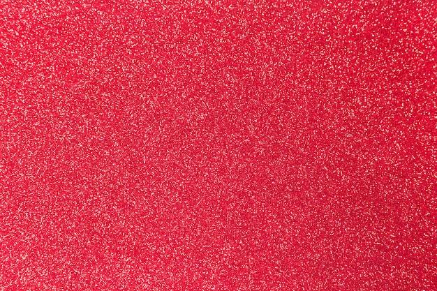 Texture brillante de paillettes rouges pour noël, concept de célébration.