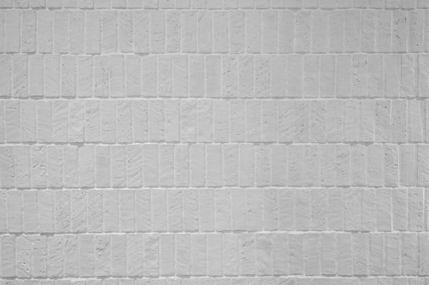 Texture de brique blanche haute résolution dans la façade du mur / texture de fond / motif sans couture / matériau altéré