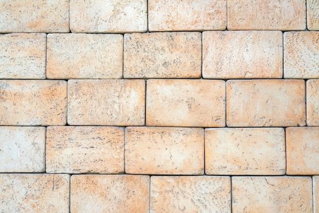 Texture de brique jaune en grès et calcaire. le mur de la maison