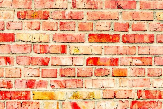 Texture, brique, mur, arrière-plan. texture de brique avec rayures et fissures