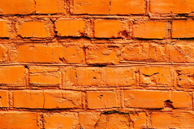 Texture de brique avec des rayures et des fissures