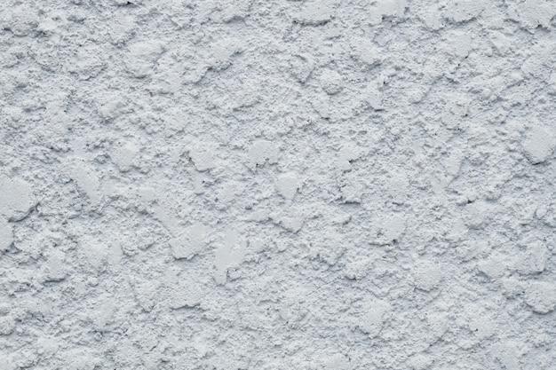 Texture brute de fond de mur de ciment gris