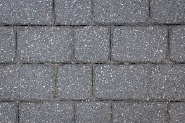 Texture de carreaux de béton. fond de chaussée de la ville.