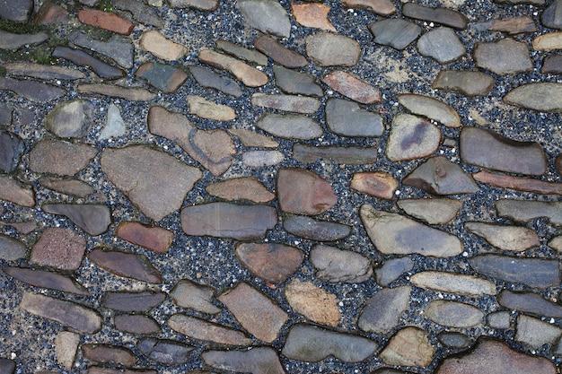 Texture de carreaux de chaussée en pierre pavés fond de briques