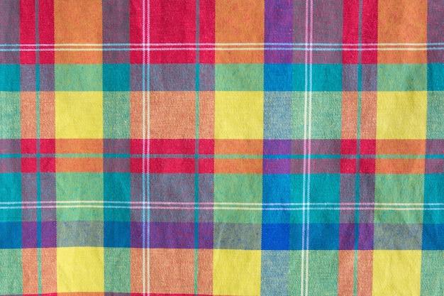 Texture à carreaux tissu coloré. fond de tissu