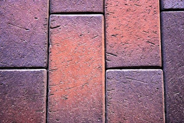 Texture de chaussée carrelée en béton en couleur