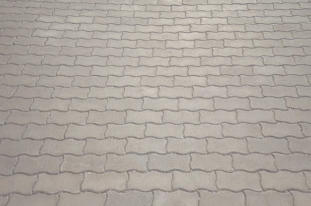 Texture de chaussée mosaïque grise ancienne route
