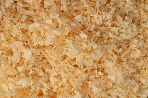 Texture de copeaux de bois, fond de poussière de scie se bouchent.