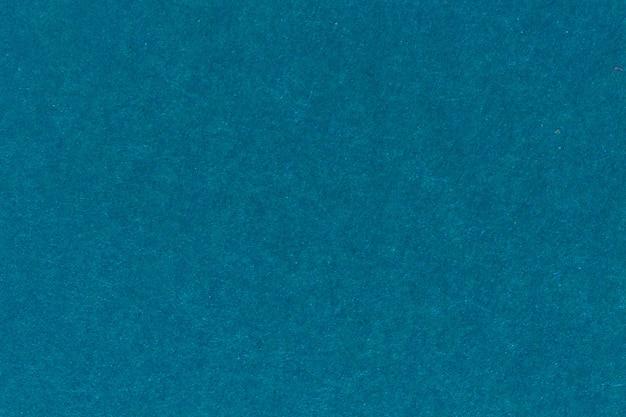 Texture de couleur bleue une feuille de papier brossé pour les arrière-plans vierges et purs. photo haute résolution.