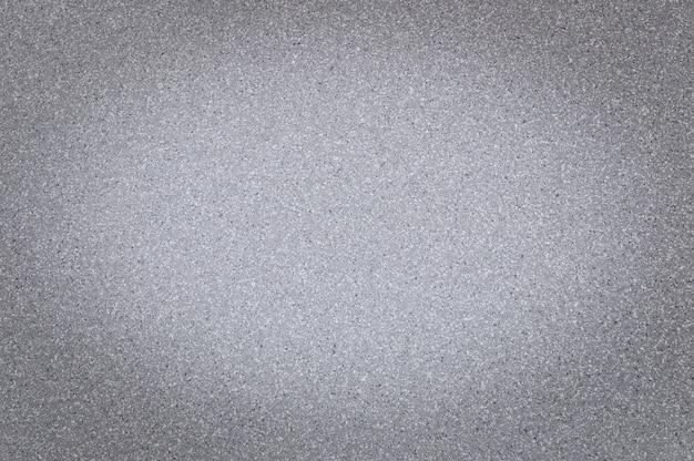 Texture de couleur gris granit avec de petits points, avec vignettage