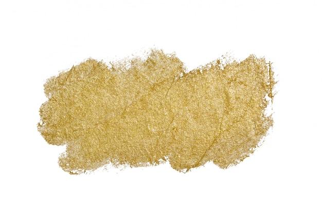 Texture de coup de pinceau de peinture dorée isolé sur blanc