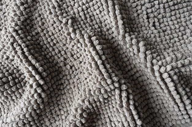 Texture d'une couverture grise faite de petites boules