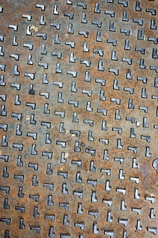 Texture de couverture de trou d'homme rustique grunge