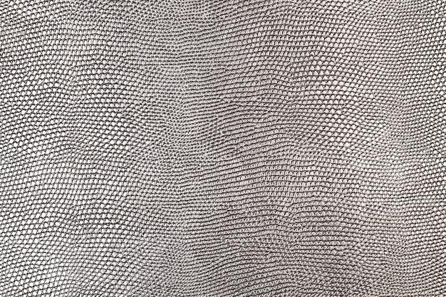 Une texture de cuir argenté dans une vue rapprochée