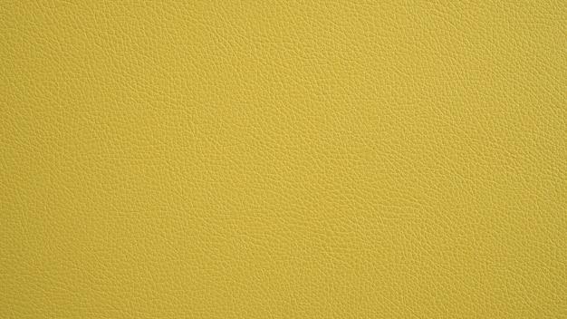 Texture de cuir jaune panorama grunge. fond jaune