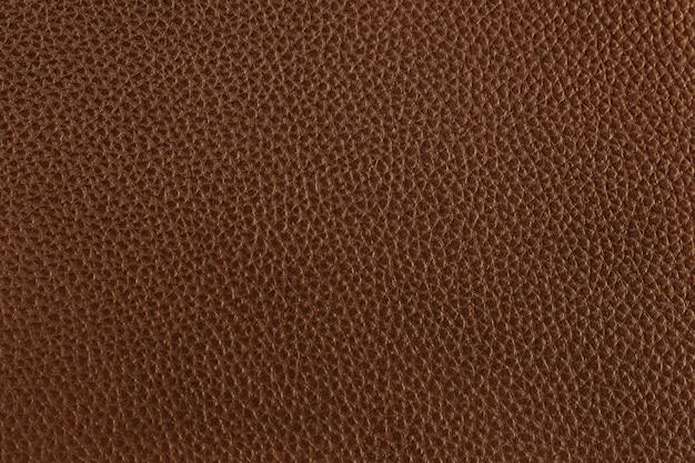 Texture de cuir marron foncé avec motif sans couture et haute résolution.