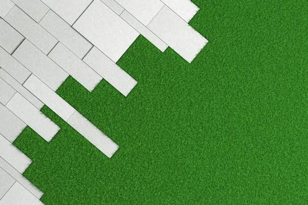 Texture de dalles de différentes tailles de béton brut posé en angle sur une pelouse verte.