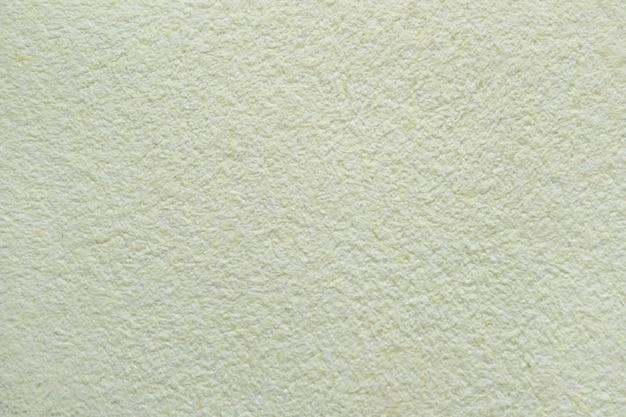 Texture décorative jaune abstraite de papier peint liquide