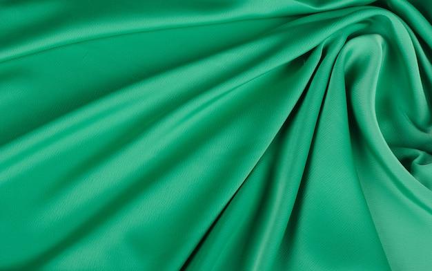 Texture délicate de tissu en mousseline de soie vert ondulé
