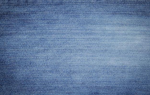 Texture denim en gros plan avec espace de copie pour fond vintage ou papier peint.