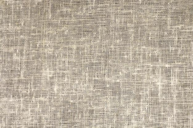 La texture dense de l'ancienne toile de jute, un tissu de lin