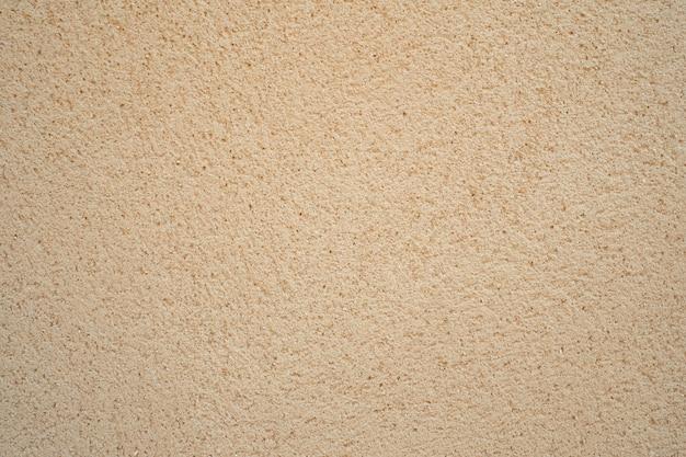 La texture du bloc de sable de couleur crème