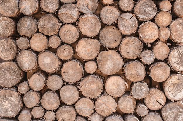 La texture du bois a beaucoup de bûches coupées dans
