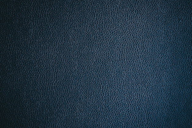 La texture du cuir bleu foncé peut être utilisée comme arrière-plan
