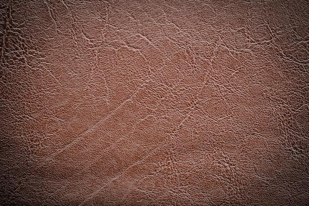 La texture du cuir marron foncé peut être utilisée comme arrière-plan