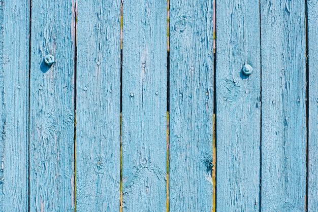 La texture du fond de planche de bois bleu