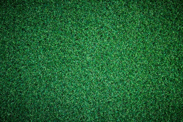 La texture du gazon artificiel ou de l'herbe verte peut être utilisée comme arrière-plan